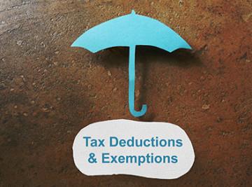 Paper umbrella over a Tax Deduction message